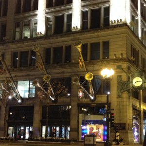 Trumpets and Holiday Story Windows outsides of Macy's on State.  Chicagoans still call it Marshall Fields